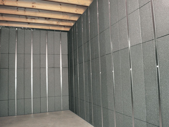 SilverGlo™ insulation and metal studs making up our Basement to Beautiful™ panels. Installed & Insulated Basement Wall Paneling in Buffalo